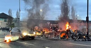 The wreckage of a bus on fire on the Shankill Road in Belfast. Photograph: Liam McBurney/PA Wire.
