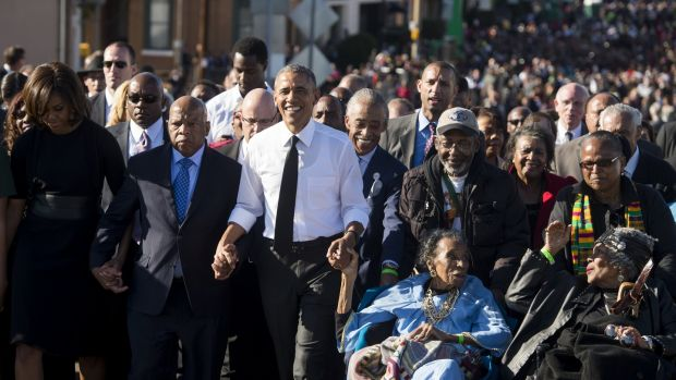 US president Barack Obama walks alongside Amelia Boynton Robinson (second right), one of the original marchers; first lady Michelle Obama; and US Representative John Lewis (second left), Democrat of Georgia, and also one of the original marchers, across the Edmund Pettus Bridge to mark the 50th anniversary of the Selma to Montgomery civil rights marches on March 7th, 2015. Photograph: Saul Loeb/AFP via Getty Images
