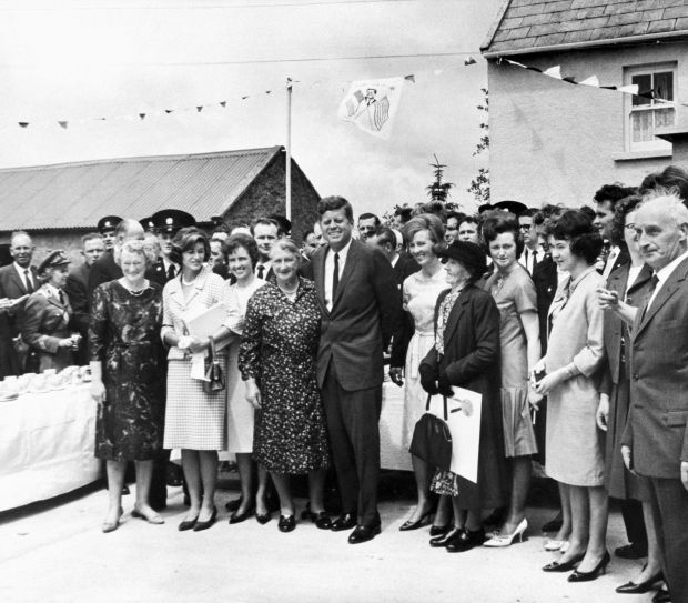 President Kennedy with relatives on a visit to Dunganstown, Co Wexford, site of the Kennedy ancestral home. Standing beside him is his sister Jean Smith; his second cousin Mary Ryan; and her daughters Josephine and Mary Ann. Photograph: Bettmann/Getty