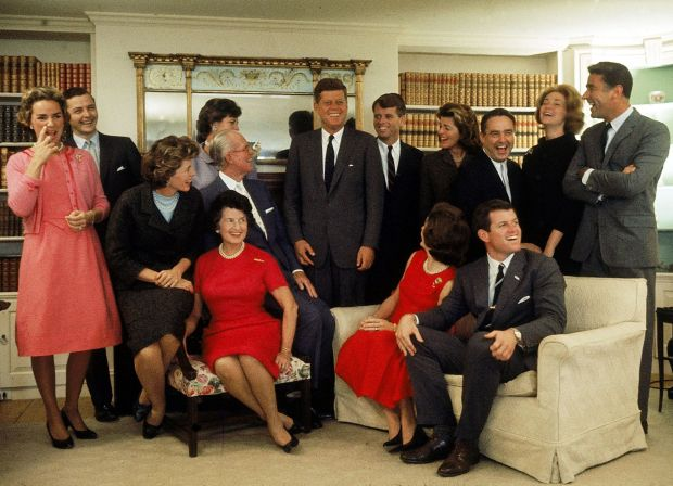 The Kennedys at Hyannis Port the night after John won the 1960 US presidential election: Eunice Shriver (on chair arm), Rose Kennedy, Joseph Kennedy, (on chair arm), Jacqueline Kennedy (head turned away from camera) and Ted Kennedy. Back row, Ethel Kennedy, Stephen Smith, Jean Smith, John F Kennedy, Robert F Kennedy, Pat Lawford, Sargent Shriver, Joan Kennedy and Peter Lawford. Photograph: Paul Schutzer/Time & Life/Getty