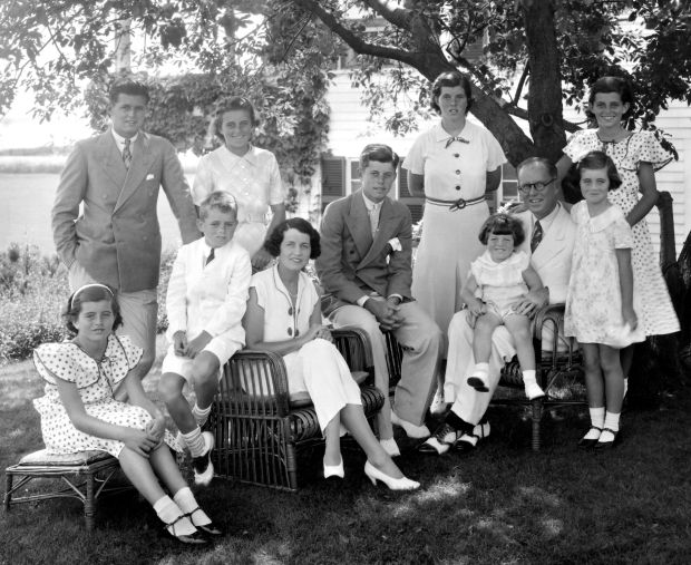 The Kennedys at Hyannis Port in the 1930s: (seated from left) Patricia Kennedy, Robert Kennedy, Rose Kennedy, John F Kennedy, Joseph P Kennedy snr with Edward Kennedy on his lap; (standing from left) Joseph P Kennedy jnr, Kathleen Kennedy, Rosemary Kennedy, Eunice Kennedy (rear, in polka dots) and Jean Kennedy. Photo by Bachrach/Getty