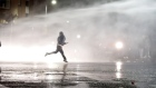 Police use water cannon and dogs at Belfast flashpoints