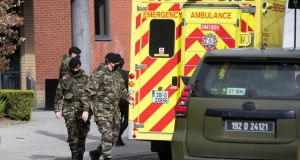 Defence Forces personnel on Friday afternoon at the  Holiday Inn Express Dublin Airport,  one of the hotels being used for mandatory quarantine. Photograph:  Colin Keegan, Collins Dublin