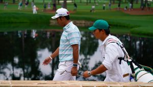 Hideki Matsuyama walks on the 15th hole with his caddie during the third round of the Masters at Augusta National. Photo: Matt Slocum/AP Photo
