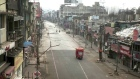 Shops shuttered, roads deserted as India battles Covid-19 spike