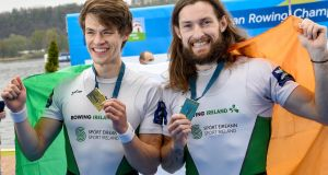 Ireland's Fintan McCarthy and Paul O'Donovan celebrate their gold medal win in Italy. Photograph: Detlev Seyb/Inpho