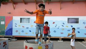 Skaramagas: boys play in a kindergarden at the refugee camp near Athens. Photograph: Panayotis Tzamaros/NurPhoto via Getty