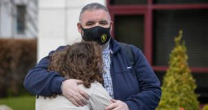 Derek Jennings from Clondalkin, Dublin with his daughter Hannah, after he was released from mandatory hotel quarantine at the Crowne Plaza at Dublin Airport. Photograph: Tom Honan/The Irish Times