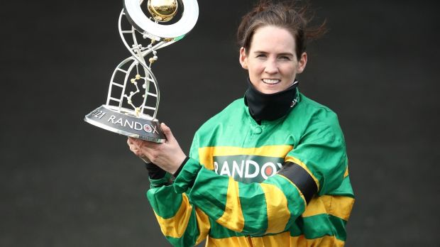 Rachael Blackmore celebrates with the trophy after winning the Grand National. Photograph: Tim Goode/PA