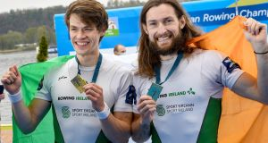 NO LIGHTWEIGHTS: Ireland's Fintan McCarthy (left) and Paul O'Donovan celebrate winning the Lightweight Men's Double A Final by showing off their 1st place medals at the 2021 European Rowing Championships at Varese, Italy. Photograph: Detlev Seyb/Inpho