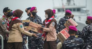 Navy personnel in Indonesia load relief supplies for people affected by Cyclone Seroja, which swept through Indonesia and East Timor last week before hitting Australia's west coast. Photograph: Juni Kriswanto/AFP via Getty