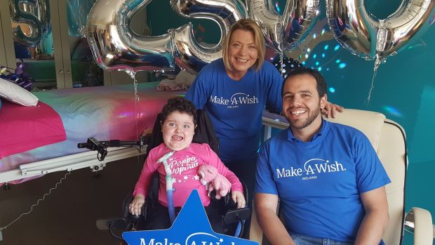 Poppy with Louise Whelan and Liam-Sean Bergin from the Make-A-Wish Foundation.