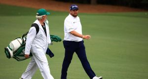 Shane Lowry and his caddie Brian 'Bo'  Martin walk to the 12th tee during the first round of the Masters at Augusta National Golf Club. Photograph: Mike Ehrmann/Getty Images
