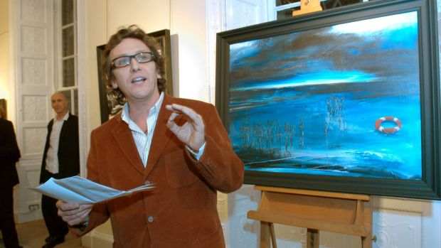 Poet Gary Jermyn reads at the opening of a Charlie Whisker show at the Solomon Gallery. Photograph: Moya Nolan