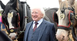 "President Michael D Higgins with ""Bud and Michael"" at the National Ploughing Championships at Ratheniska, Co Laois in September 2014. Photograph: Eric Luke"