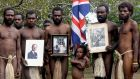 Yakel tribesmen who worship Britain's Prince Philip, the Duke of Edinburgh, hold portraits of him in the remote Pacific village of Vanuatu. Photograph: Dan McGarry