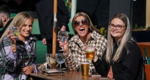 Charlotte Cunningham, Charlette Harris and Chelsea Whyman at the opening of outdoor entertainment Burn It Up in North Shields, Tyne and Wear on Monday, as England takes another step back towards normality with the further easing of lockdown restrictions. Photograph:  Owen Humphreys/PA Wire