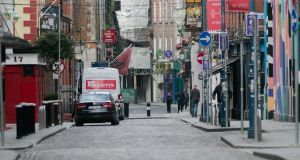 Temple Bar has long been one of Dublin busiest hotspots for socialising. But the street are largely empty due to Covid 19 restrictions. Photograph: Gareth Chaney/Collins