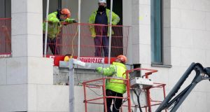 Construction workers return to an apartment block site in Finglas after some  Level-5 restrictions were lifted. Photograph: Colin Keegan