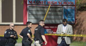 Law enforcement officers respond to a shooting at Austin-East Magnet High School in Knoxville, Tennessee, on Monday. Photograph: Saul Young/News Sentinel/AP