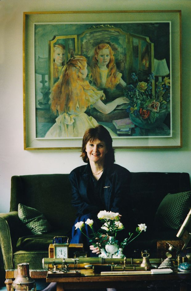 Poet Eavan Boland at her home in April 1992, with the portrait by her mother, Frances Kelly. Photograph: Joe St Leger / The Irish Times