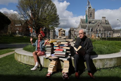 LITERATURE FESTIVAL: Author John Banville and Alisha Katongole (8) pictured with a life-sized person made of books in the Peace Garden in Dublin, to mark the announcement of the programme for International Literature Festival Dublin. Photograph: Nick Bradshaw/The Irish Times