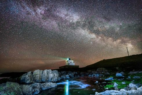 STARS: The core of the Milky Way becomes visible in the early hours of Tuesday morning as it moves over Bamburgh Lighthouse at stag Rock in Northumberland, England. Photograph: Owen Humphreys/PA Wire