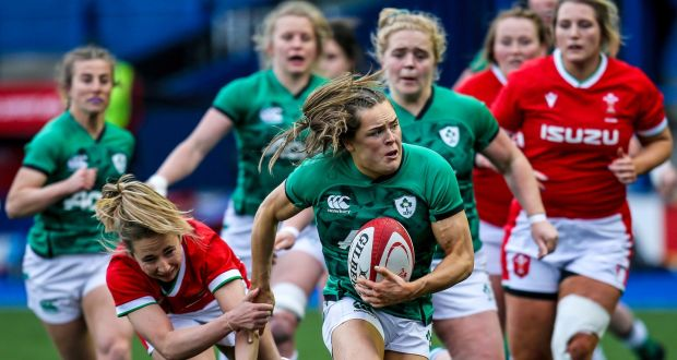 Ireland's Béibhinn Parsons goes past Elinor Snowsill of Wales during the Women's Six Nations match at  Cardiff Arms Park. Photograph: Robbie Stephenson/Inpho