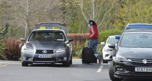Person who had finished their quarantine period departing the Crowne Plaza Hotel in Santry lasy week. Photograph: Alan Betson / The Irish Times