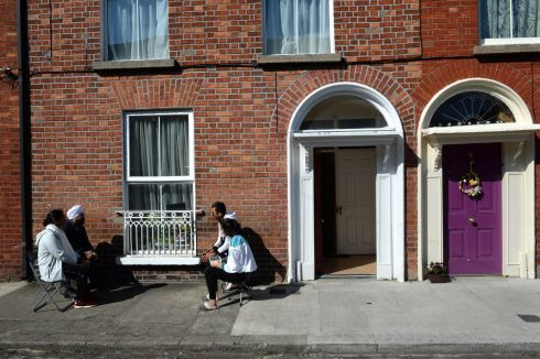 WORD ON THE STREET: Neighbours enjoy a chat, on Florence Street, Dublin. Photograph: Dara Mac Dónaill/The Irish Times