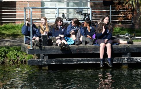 SCHOOL BREAK: Students enjoy the weather along the Grand Canal in Portobello, Dublin. Photograph: Dara Mac Dónaill/The Irish Times