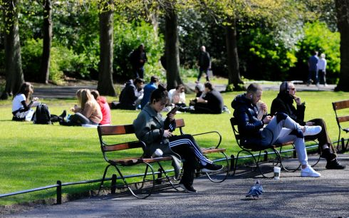 PLACE IN THE SUN: People enjoy the good weather in St Stephen's Green, Dublin. Photograph: Gareth Chaney/Collins