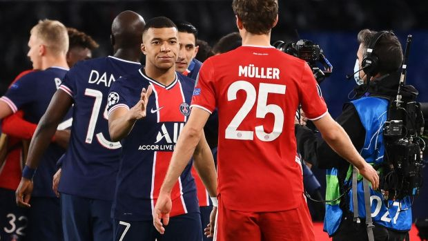 Paris Saint-Germain's Kylian Mbappe shakes hands with Bayern Munich's Thomas Müller after the Champions League quarter-final, second leg at the Parc des Princes. Photograph: Franck Fife/AFP via Getty Images