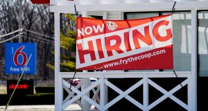 Now hiring: The number of Americans applying for unemployment benefits fell sharply last week. Photograph: Nam Y Huh/AP
