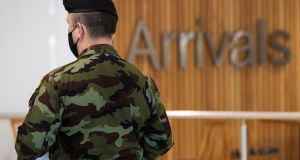 Members of the Defence Forces in Terminal 1 arrivals hall at Dublin Airport as the State's mandatory quarantine system was expanded on Thursday. Photograph: Brian Lawless/PA Wire
