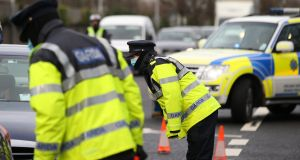 An Garda Síochána said that all occupants of a  car taking a non-essential journey would be fined. File photograph: Stephen Collins/Collins Photos