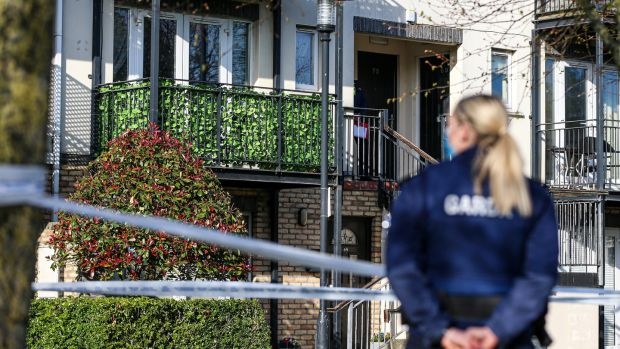 Gardaí at the scene of an assault in Finglas in which a young woman died. Photograph: Damien Storan