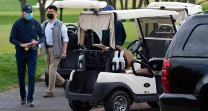 US president Joe Biden leaves his cart after a round of golf at Wilmington Country Club. Photo: Jim Watson/AFP via Getty Images