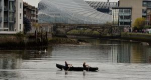 Currach rowers and members of Draiocht Na Life Tomas Madden and Frank Tate  during their weekly practice which takes them from Poolbeg Yacht and Boat club to Island Bridge, tide permitting.  Photograph: Alan Betson/The Irish Times