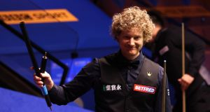Neil Robertson celebrates victory against Liang Wenbo at The Crucible. Photograph: PA