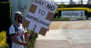 A Tottenham Hotspur fan protests against the club's decision to be included in the new super league.Photograph: Jonathan Brady/PA Wire