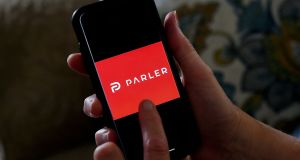 This illustration file photo taken on July 2nd, 2020 shows social media application logo Parler displayed on a smartphone in Arlington, Virginia. Photograph:  by Olivier Douliery/AFP/Getty Images