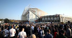 Fans gather outside Elland Road on Monday night. Photograph: PA