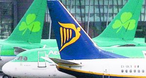 Ryanair and Aer Lingus planes on the runway at Dublin Airport.