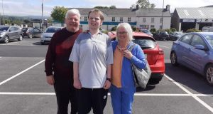 Jeremiah Cronin (21) with his father Daniel and mother Margaret Cronin. Ms Cronin said she was shocked to learn that her son's records were being used by the Department of Health without her consent.