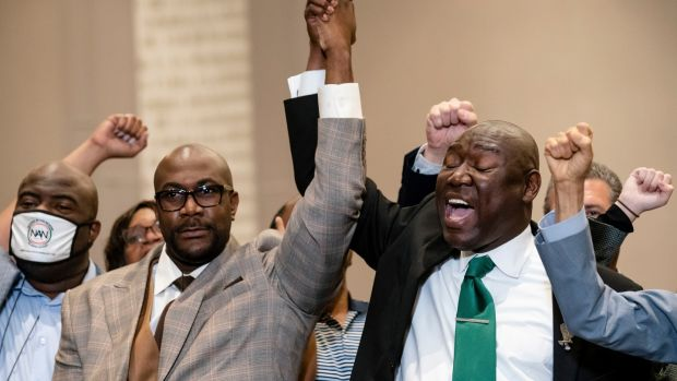 Philonise Floyd, brother of George Floyd (left), and attorney Ben Crump raise their hands in triumph during a news conference after the murder conviction against former Minneapolis police officer Derek Chauvin in the killing of George Floyd. Photograph: John Minchillo/AP