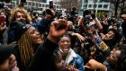 People celebrate as the verdict is announced in the trial of Derek Chauvin outside the Hennepin County Government Centre in Minneapolis. Photograph: Chandan Khanna/AFP