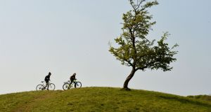 ROLLING HILLS: Bikers enjoy the warmer weather with a visit to the Phoenix Park in Dublin. Photograph: Alan Betson