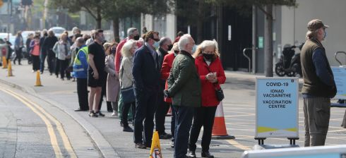 GETTING THEIR SHOTS: A queue of expectant people gather outside the Covid-19 vaccination centre at the Aviva Stadium in Dublin. Photograph: Niall Carson/PA Wire
