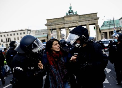 COME WITH US: Riot police detain a protester during a rally in Berlin against the German government's policy on containing the coronavirus pandemic. The parliament has made changes to the Protection against Infection Act, granting the federal government more powers in enforcement of anti-Covid-19 measures. Photograph: Filip Singer/EPA